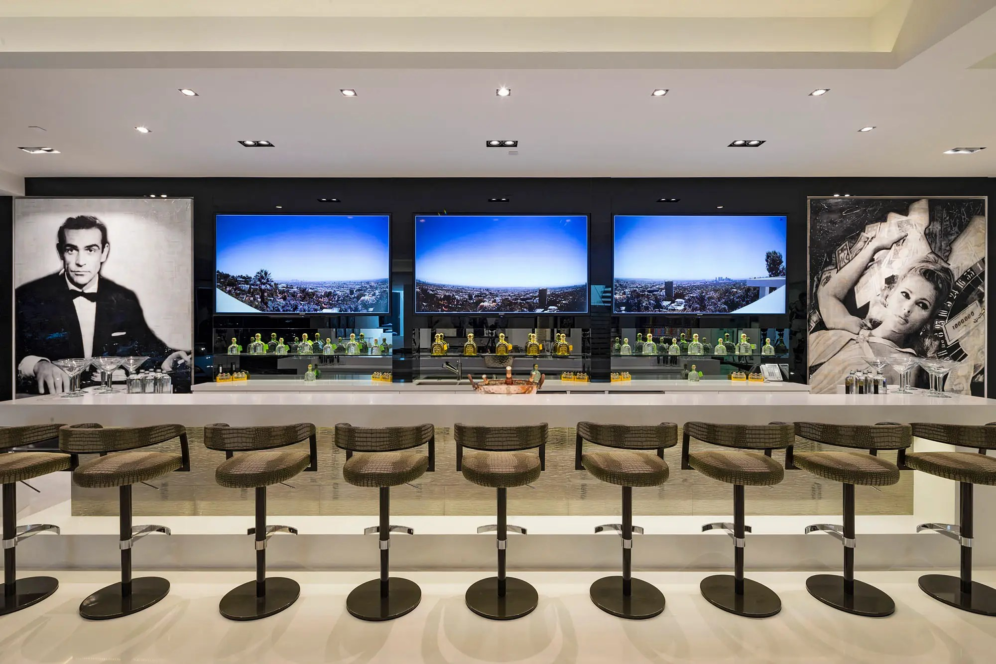 There's also a fully stocked bar with ample bar stools.