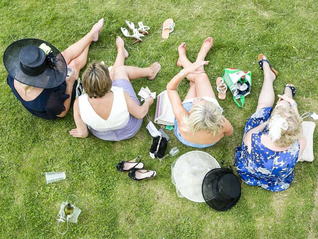 wealthy women sitting grass