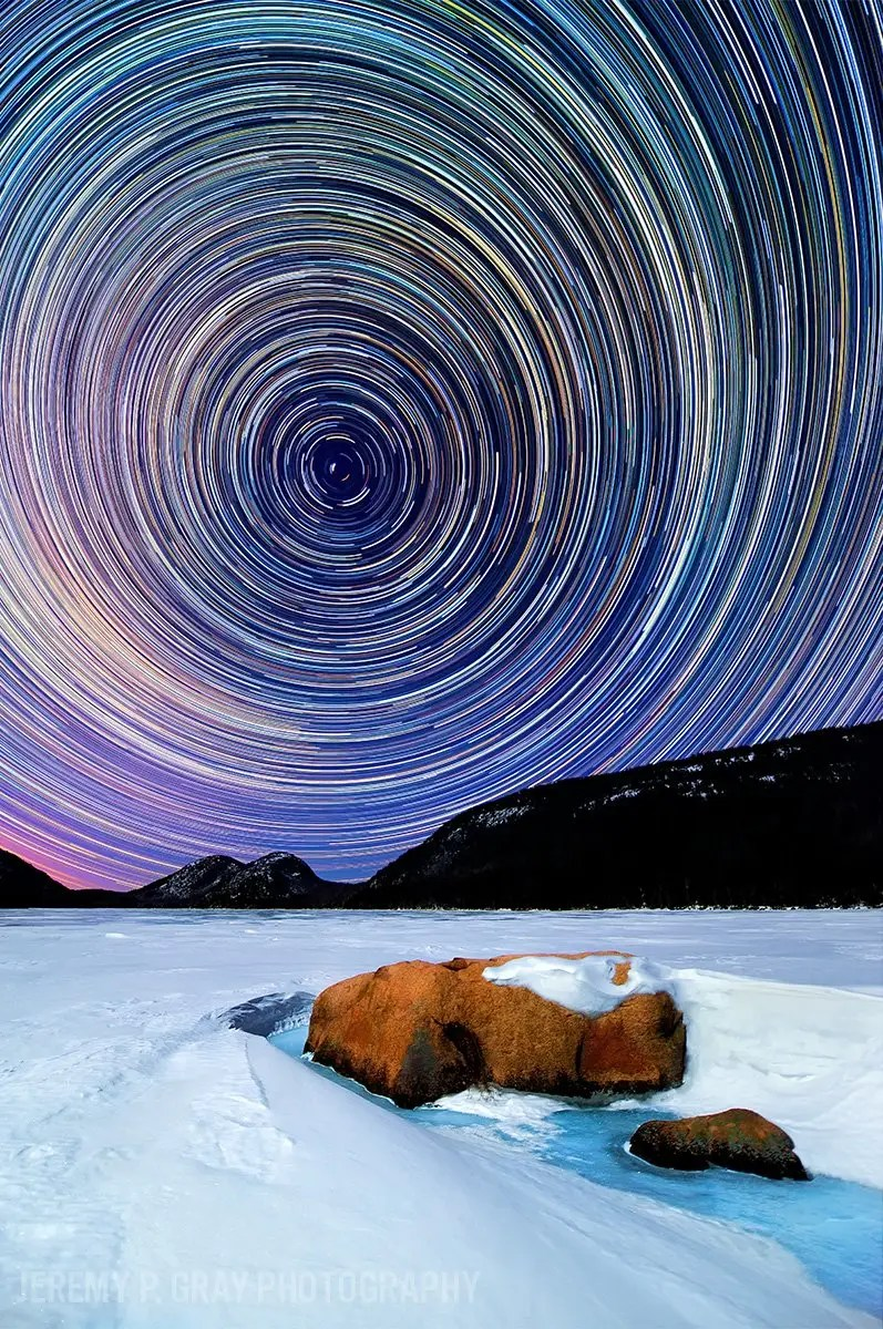 "Jeremy Gray shoots incredible images of Maine's night sky. Mesmerizing star trails paint the night sky along the frozen, snow-blanketed banks of Jordan Pond in Acadia National Park in this image Gray dubbed ""Celestial Winter."""