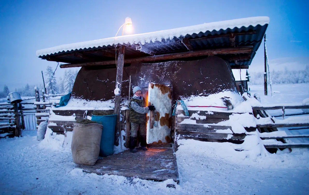 """Today, the town averages -58 °F in the winter months. In the Even language spoken in Siberia, Oymyakon means """"unfrozen water,"""" believe it or not. It is thought to reference the thermal springs in town that reindeer herders used to visit."""
