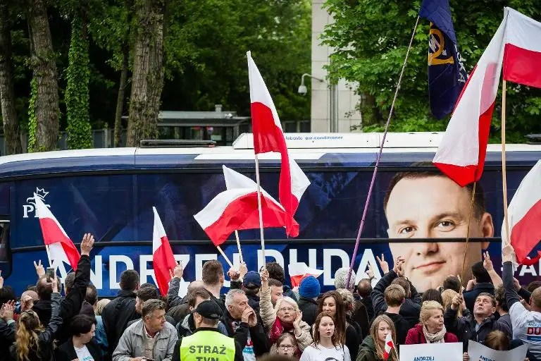 Poles vote Sunday in the second round of a too-close-to-call presidential election with incumbent centrist Bronislaw Komorowski trying to fend off the populist challenge of conservative newcomer Andrzej Duda, pictured on campaign bus
