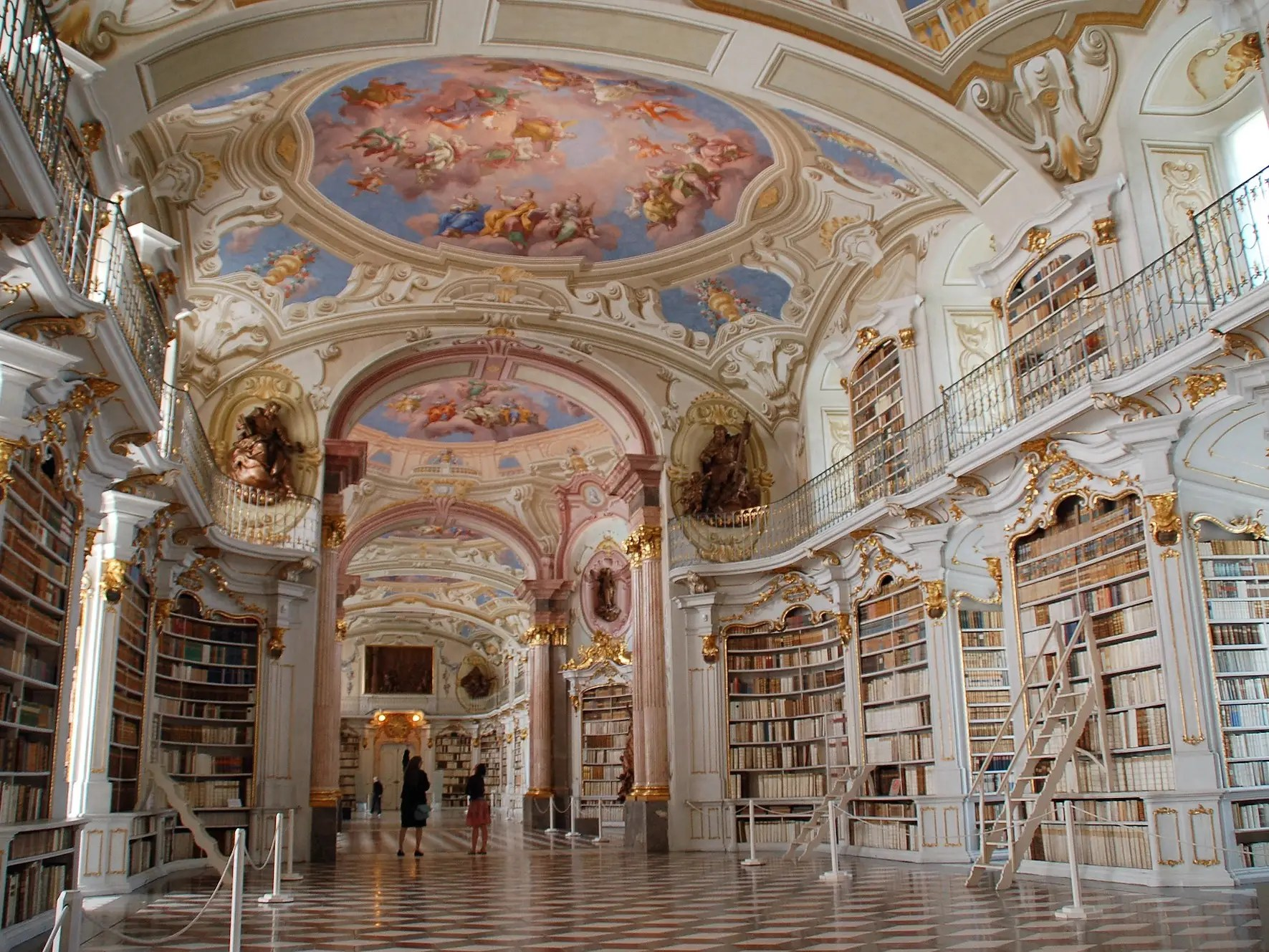 With the Alps as a background, the Admont Library — located in the Admont Monastery in Admont, Austria — is the second largest monastery library in the world. The beautiful painted ceilings depict the various stages of human knowledge.