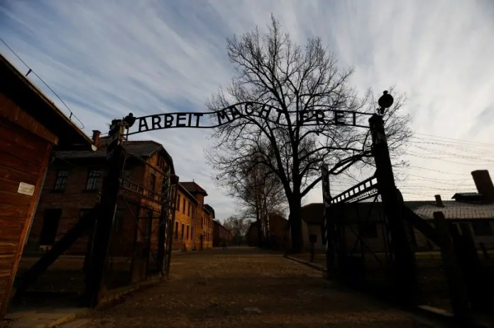 A general view of main gate of the former Nazi concentration camp Auschwitz-Birkenau is pictured in Oswiecim December 10, 2014.  REUTERS/Kacper Pempel  Why tourists go to sites associated with death and suffering Why tourists go to sites associated with death and suffering german court declares 93 year old auschwitz ss guard fit for trial