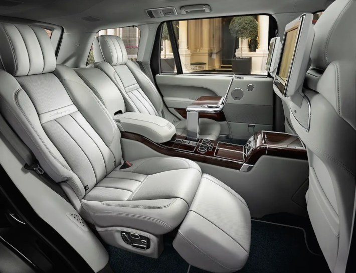 The rear passenger seats come with a little foot rest for ultimate relaxation. They also recline and can give you a massage!