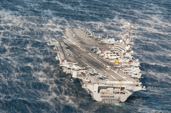 The aircraft carrier USS George H.W. Bush transits the Atlantic Ocean while conducting a composite training unit exercise (COMPTUEX) on November 24, 2013. COMPTUEX is a scenario-driven exercise aimed at integrating the ships of the George H.W. Bush Strike Group through a series of live training events.