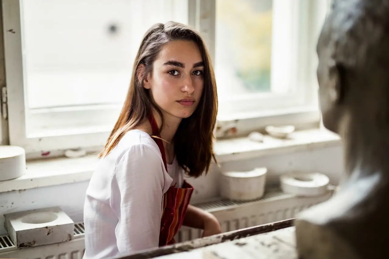 Noroc also traveled around her home country of Romania. Here, a ceramic art student in a workshop in Cluj, Romania.