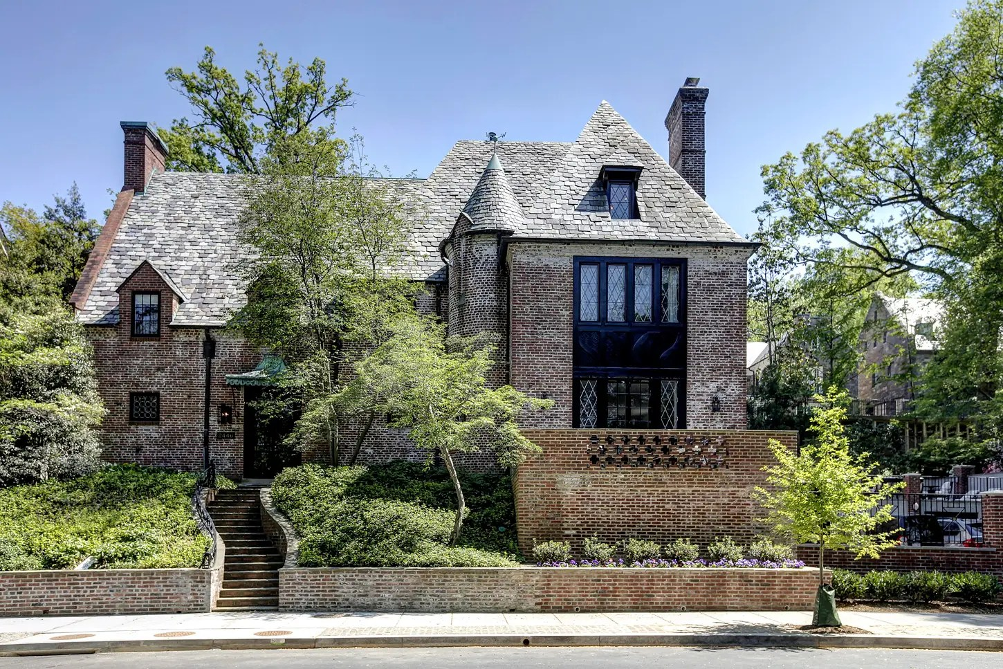 The Obamas traded white for brick at their newly purchased mansion in the Kalorama neighborhood of Washington, DC.