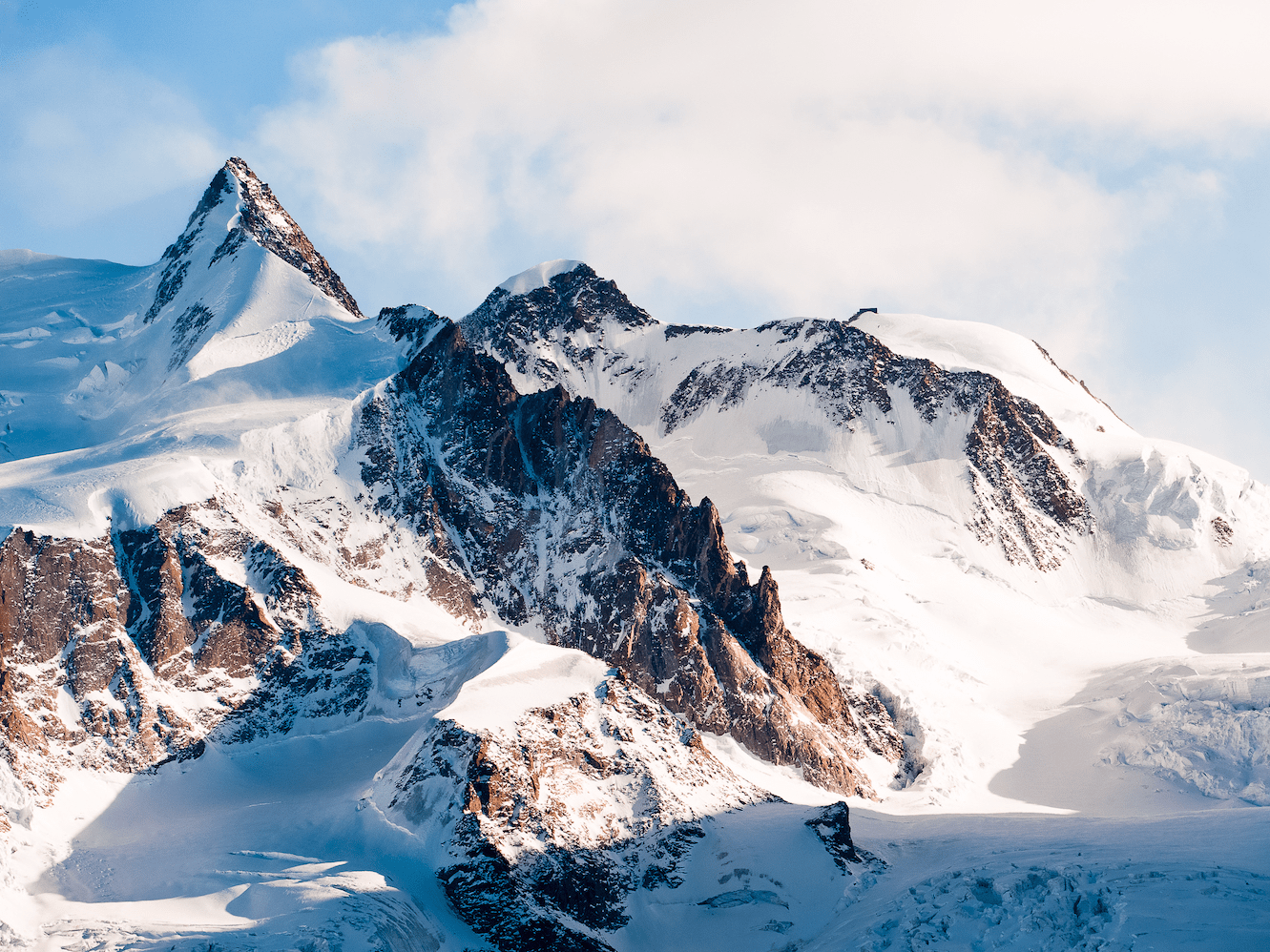 The Alps run through much of Switzerland, and the country's highest peak is the Dufourspitze, which is part of Monte Rosa, a group of mountains that sit on Switzerland's border with Italy.