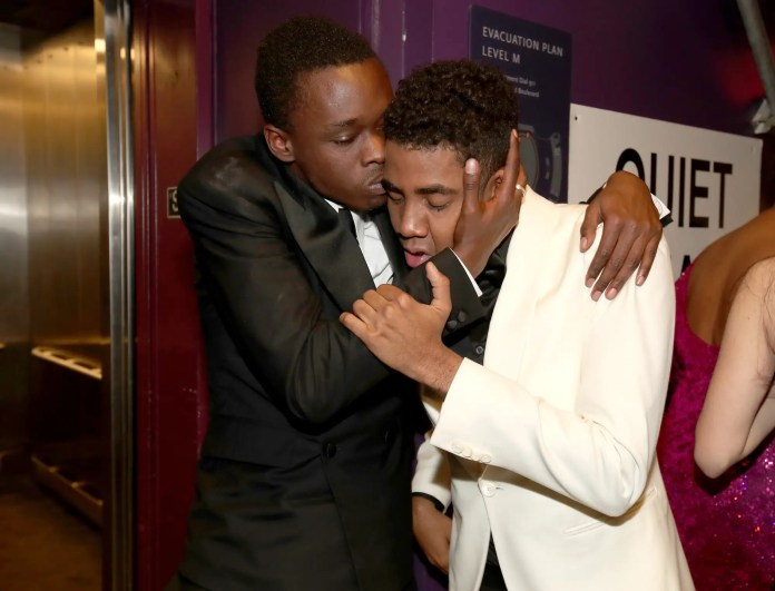 """Moonlight"" actors Ashton Sanders and Jharrel Jerome embrace backstage."