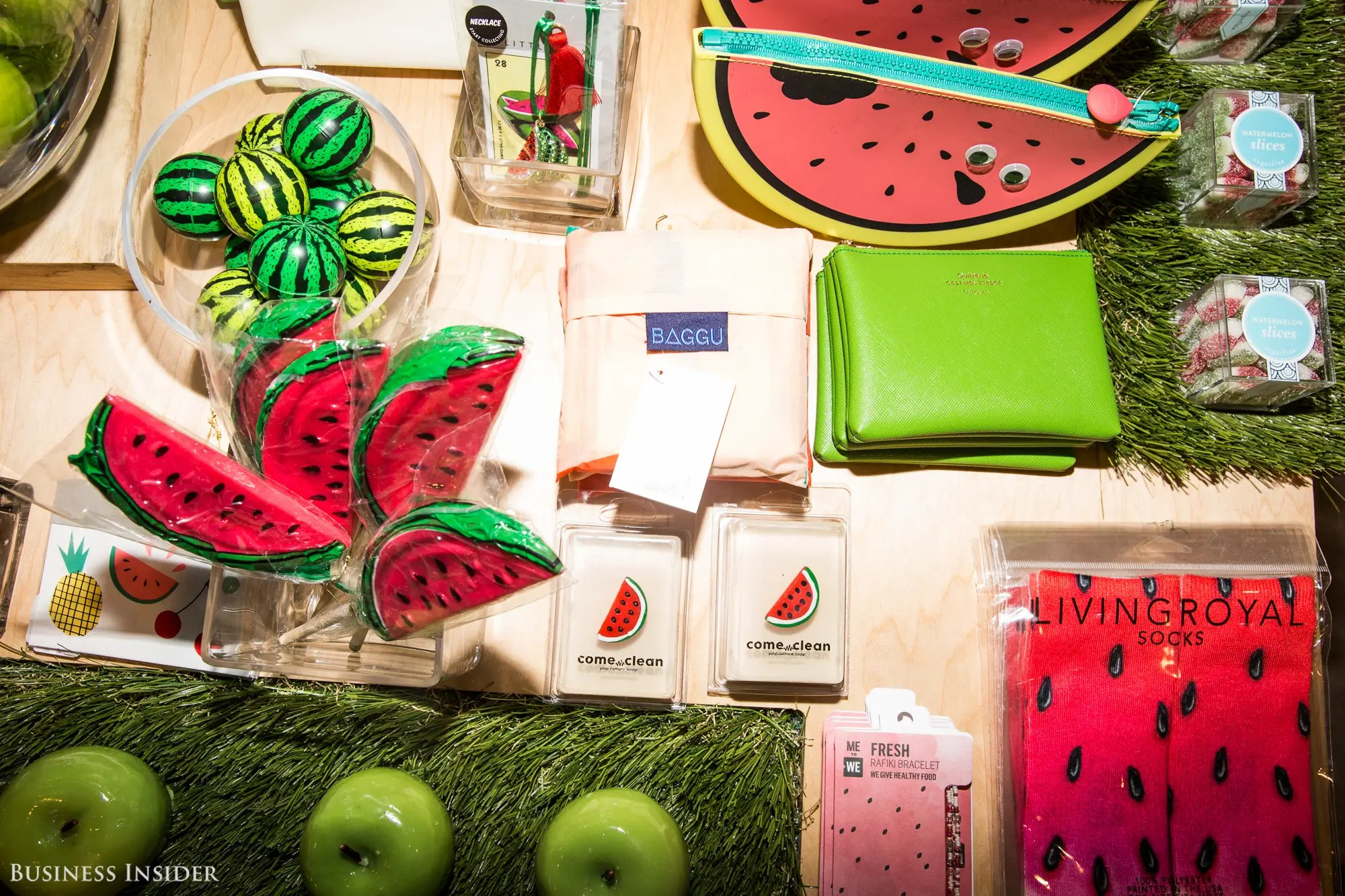 Everything inside the space is food-themed, like these watermelon wallets and socks: