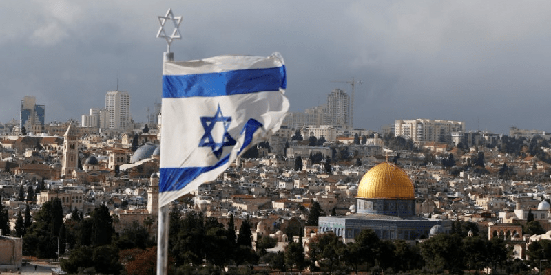FILE PHOTO: An Israeli flag is seen near the Dome of the Rock, located in Jerusalem's Old City on the compound known to Muslims as Noble Sanctuary and to Jews as Temple Mount December 6, 2017. REUTERS/Ammar Awad/File Photo