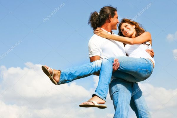 Young man holding woman in his arms ⬇ Stock Photo, Image ...