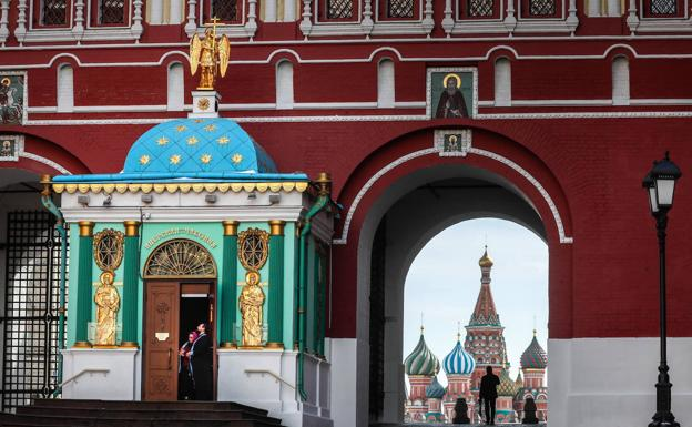A man walks through the Red Square in Moscow