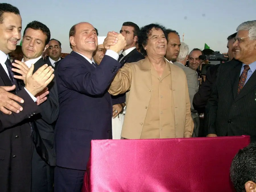 Qaddafi and Italian PM Silvio Berlusconi during the inauguration of a multibillion-dollar natural gas pipeline linking their two countries beneath the Mediterranean, Oct. 7, 2004