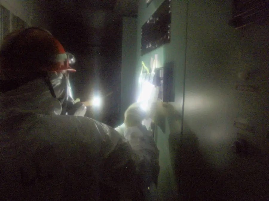 When they take a break, the workers rest and eat in a small decontaminated room