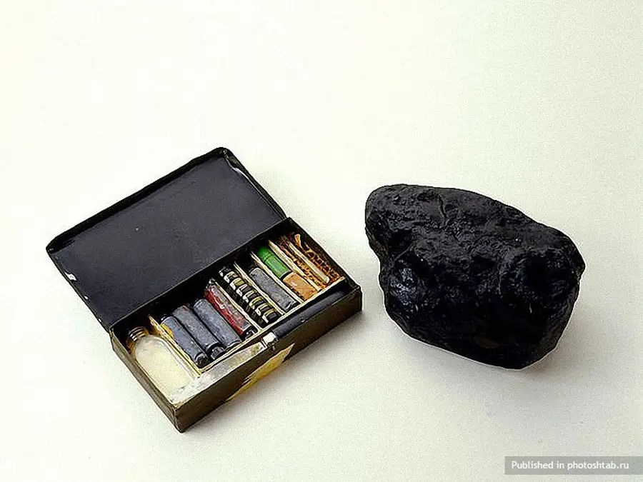 A CIA bomb disguised as a rock (the other box contains camouflage paint for the bomb).