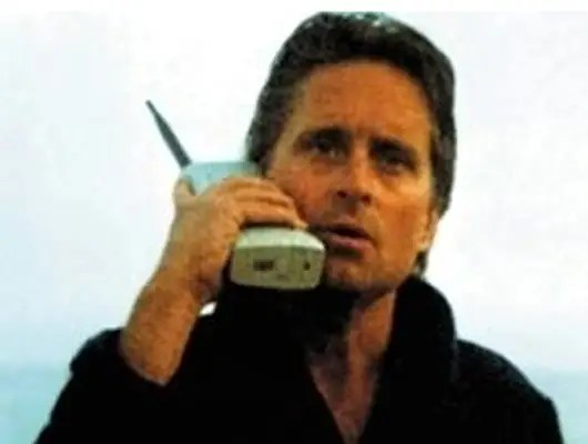 """1987: Michael Douglas' character Gordon Gekko had very important business to take care of over the phone in """"Wall Street."""""""