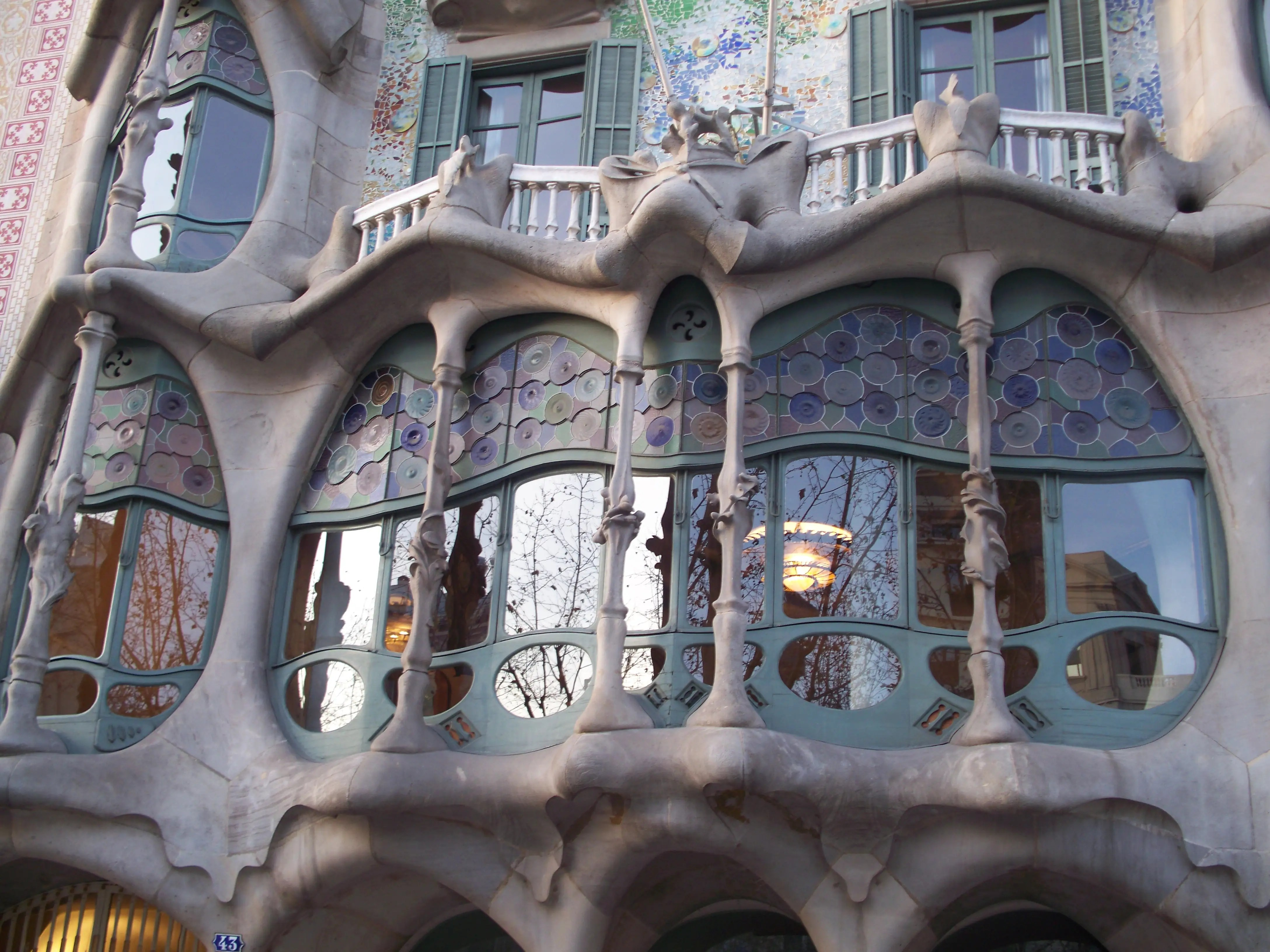 Gaudí restored the Casa Batlló (originally constructed in 1877) between 1904 and 1906. The facade is covered in mosaic tiles and feels skeletal.
