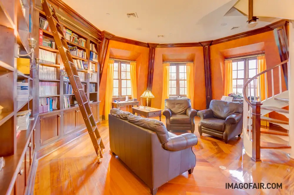 The library is also full of natural light and dark touches complement the rich wood paneling. Bonus: it has a ladder that slides slide across the entire bookcase.