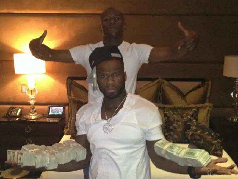 He hung out with 50 Cent, who balanced what looks like $400,000 on his forearms.