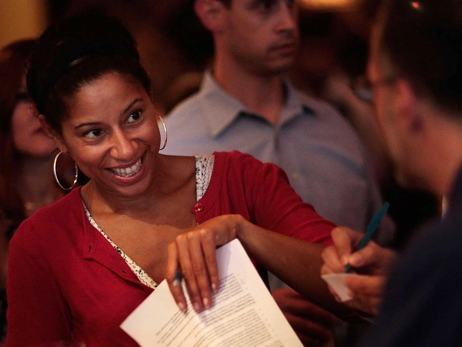 black woman smiling resume job interview