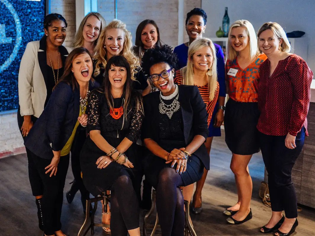 women laughing work businesswomen