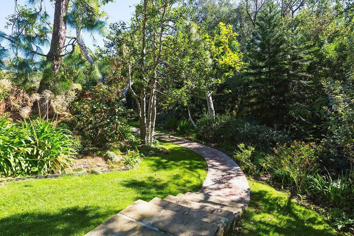 It sits on 1.6 acres of impeccably manicured land, and has stone paths running across the property.