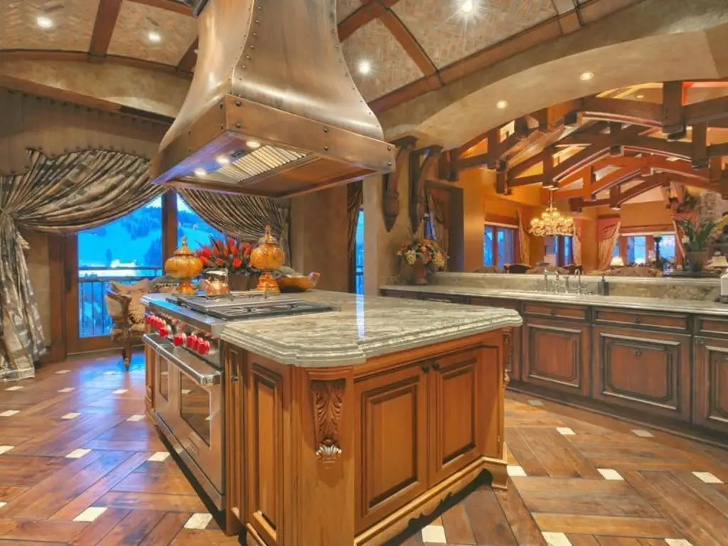 The gourmet kitchen is equipped with Wolf appliances with a large central island.
