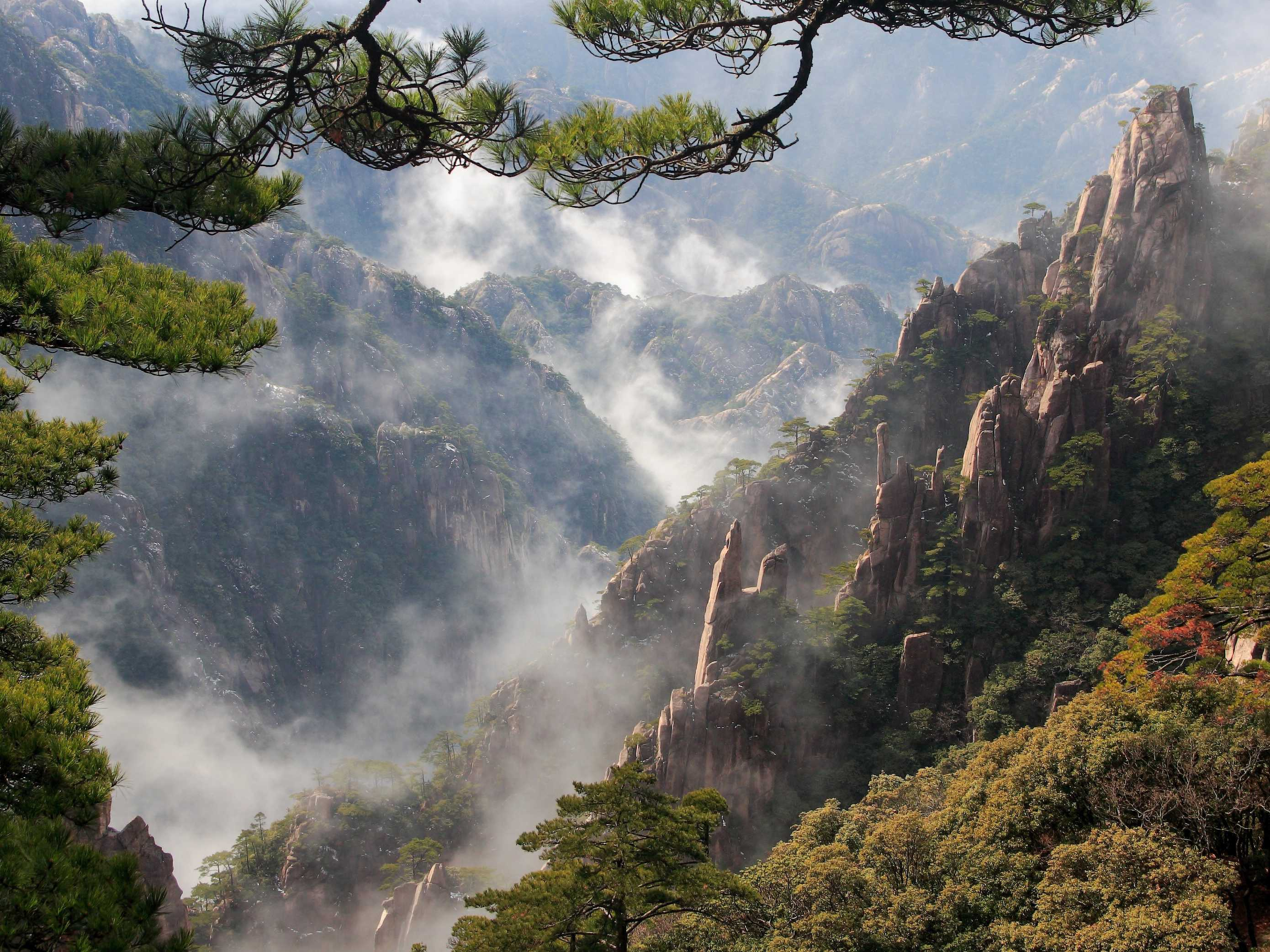 Step into the dreamy landscape of China's Huangshan Mountain.