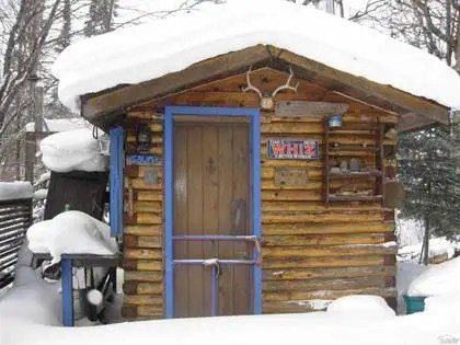 A handcrafted log cabin that looks over Lake Superior.
