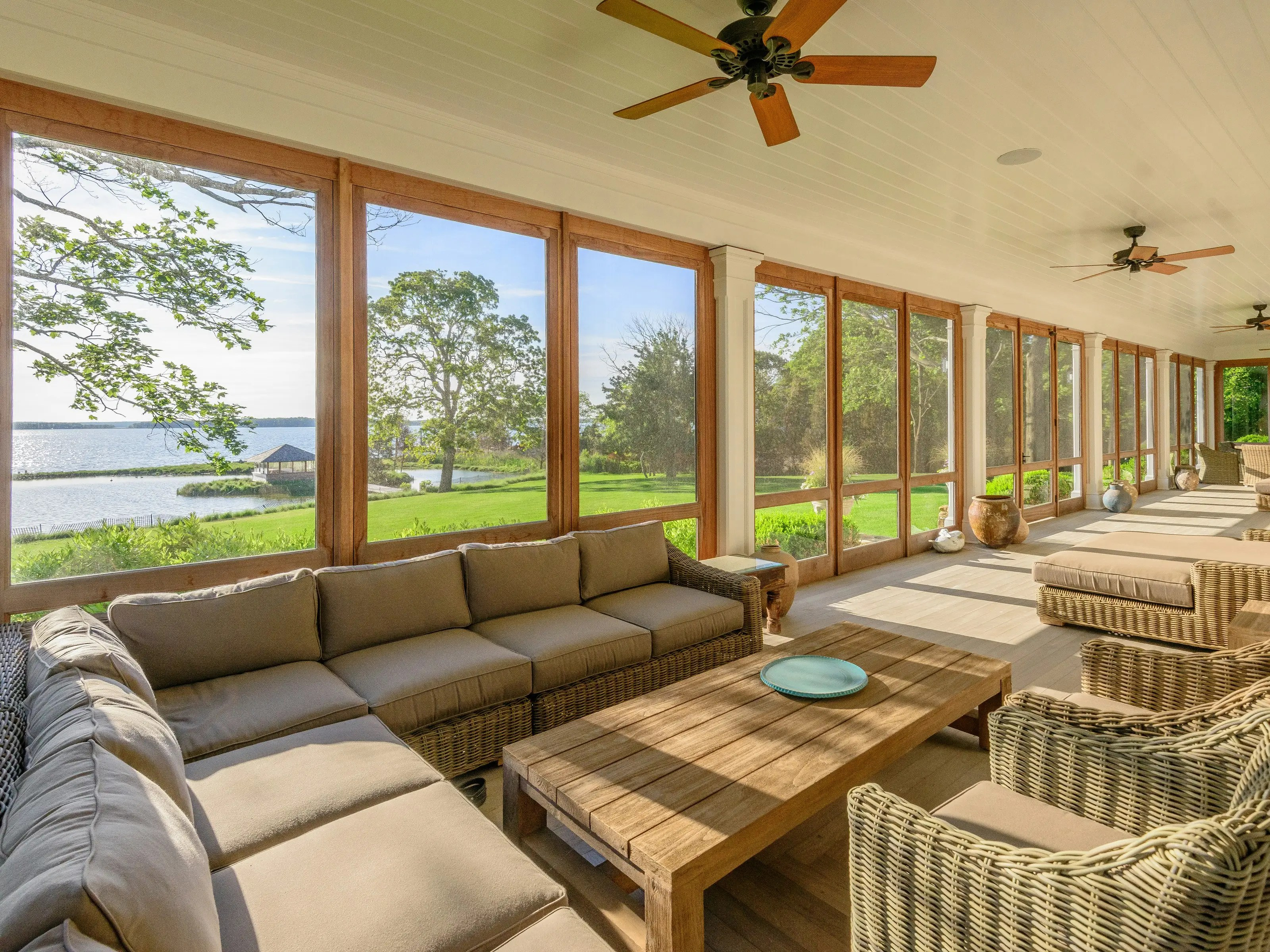 You can lounge in the vast sunroom which looks out toward the water.
