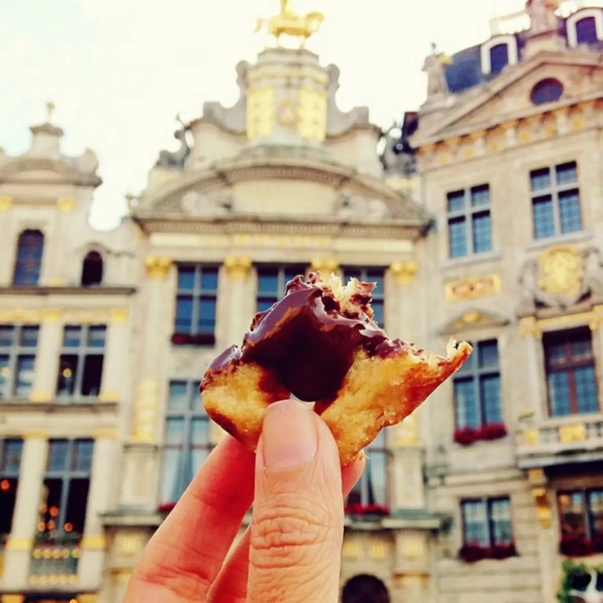 Belgian waffles (with Nutella!) in front of my favorite building, the Grand Place in Brussels, Belgium.