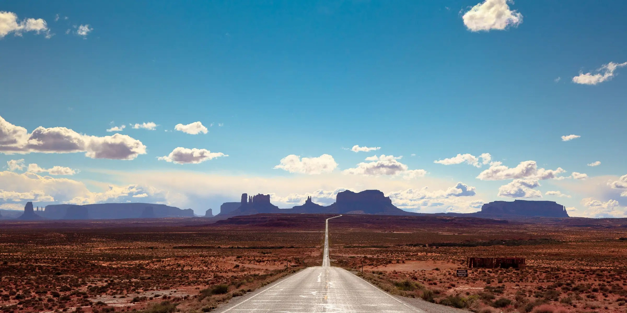 Scenic Byway 163 stretches from the Arizona border through Monument Valley in Utah. During the 45-mile drive, you'll be able to admire the beautiful red rocks and desert.