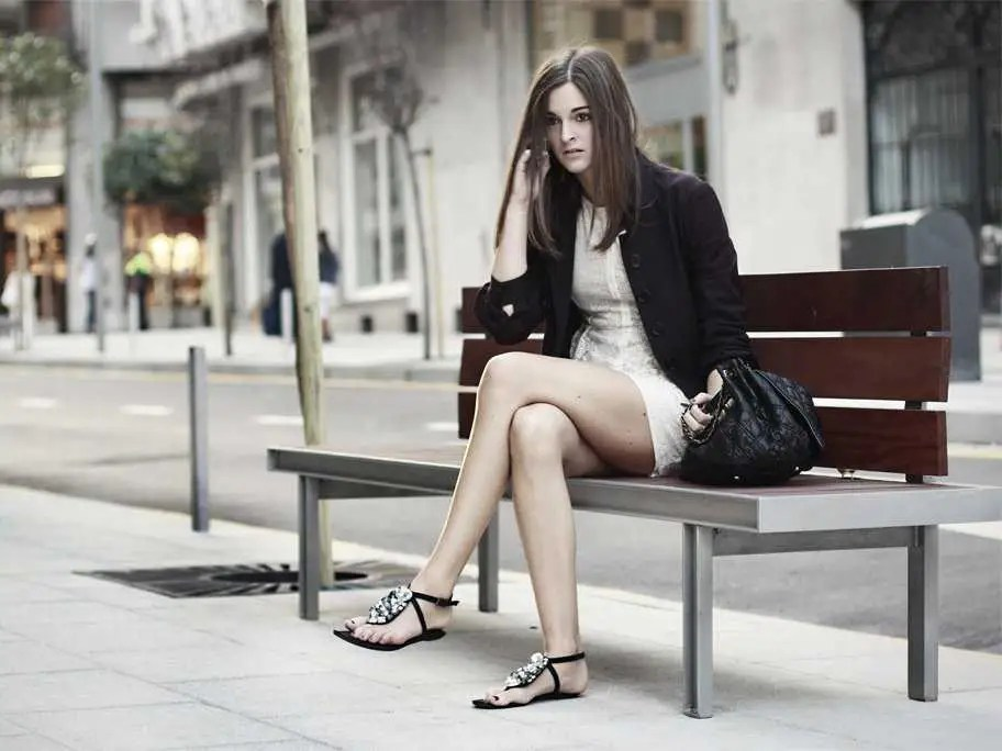 girl sitting bench cell phone