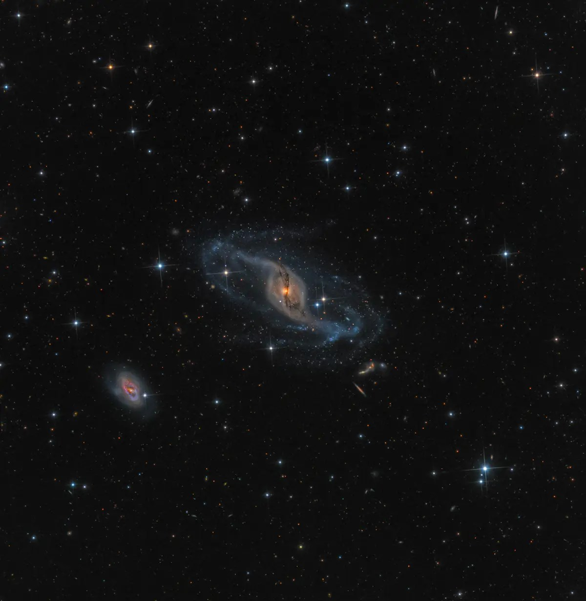 "This photo, taken by Mark Hanson at the Rancho Hidalgo Observatory in Animas, New Mexico, of the NGC 3718 galaxy won the award for best ""Robotic Scope"" image. ""Gravitational interactions with its near neighbor NGC 3729 (the spiral galaxy below and to the left) are the likely reason for the galaxy's warped spiral arms,"" the Royal Observatory explains."