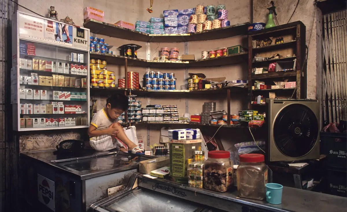 Often, commercial spaces like this grocery store would double as a living room or a space for the children to do homework after the working day was over.