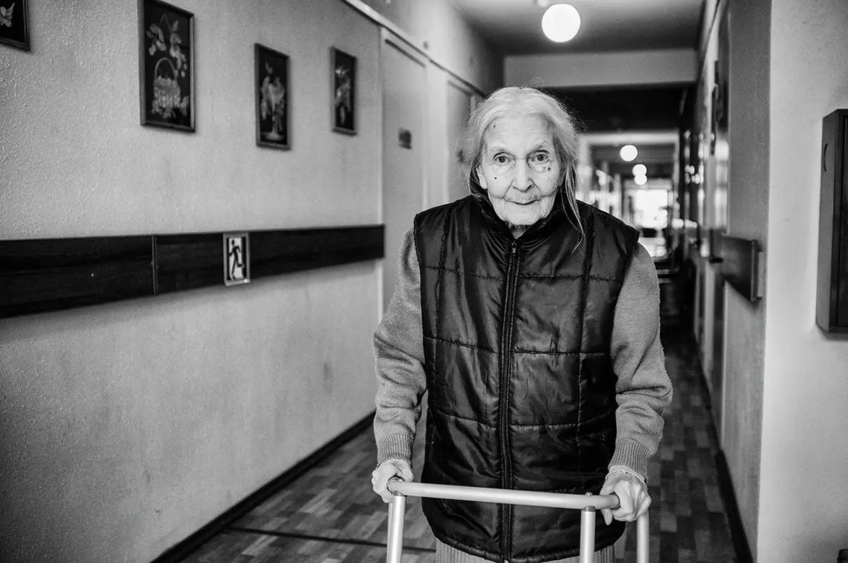 "Nadezda, age 96. Profession: Production engineer. Passion or Dream: ""I want peace and quiet. My life was very stressful."""