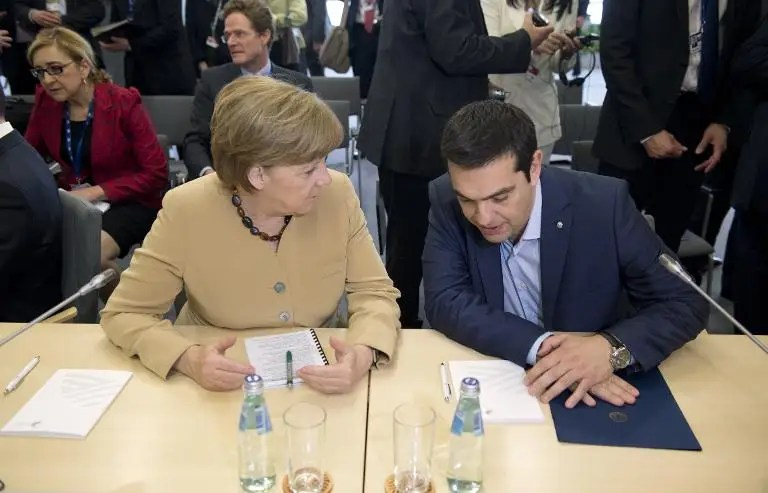 German chancellor Angela Merkel (L) talks with Greek Prime Minister Alexis Tsipras at the EU Eastern Partnership Summit in Riga, on May 22, 2015