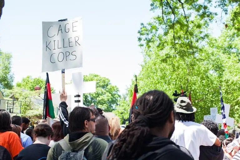 People protest outside the house of Prosecutor Timothy McGinty in reaction to Cleveland police officer Michael Brelo being acquitted of manslaughter charges, on May 23, 2015 in Cleveland, Ohio