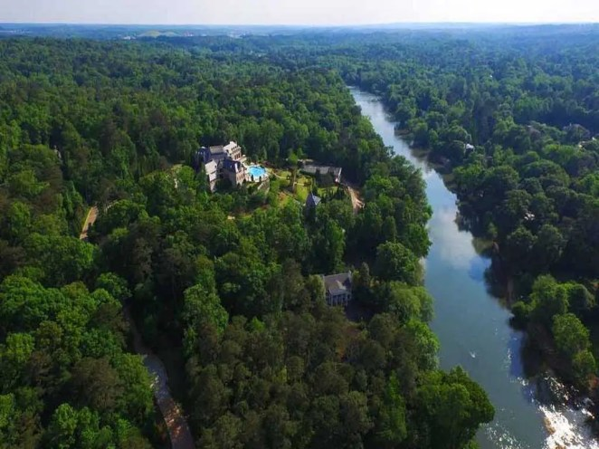 """Built in 2007 along the Chattahoochee River, it's described as """"the most compelling private residence to ever be offered to market in the history of Atlanta."""""""