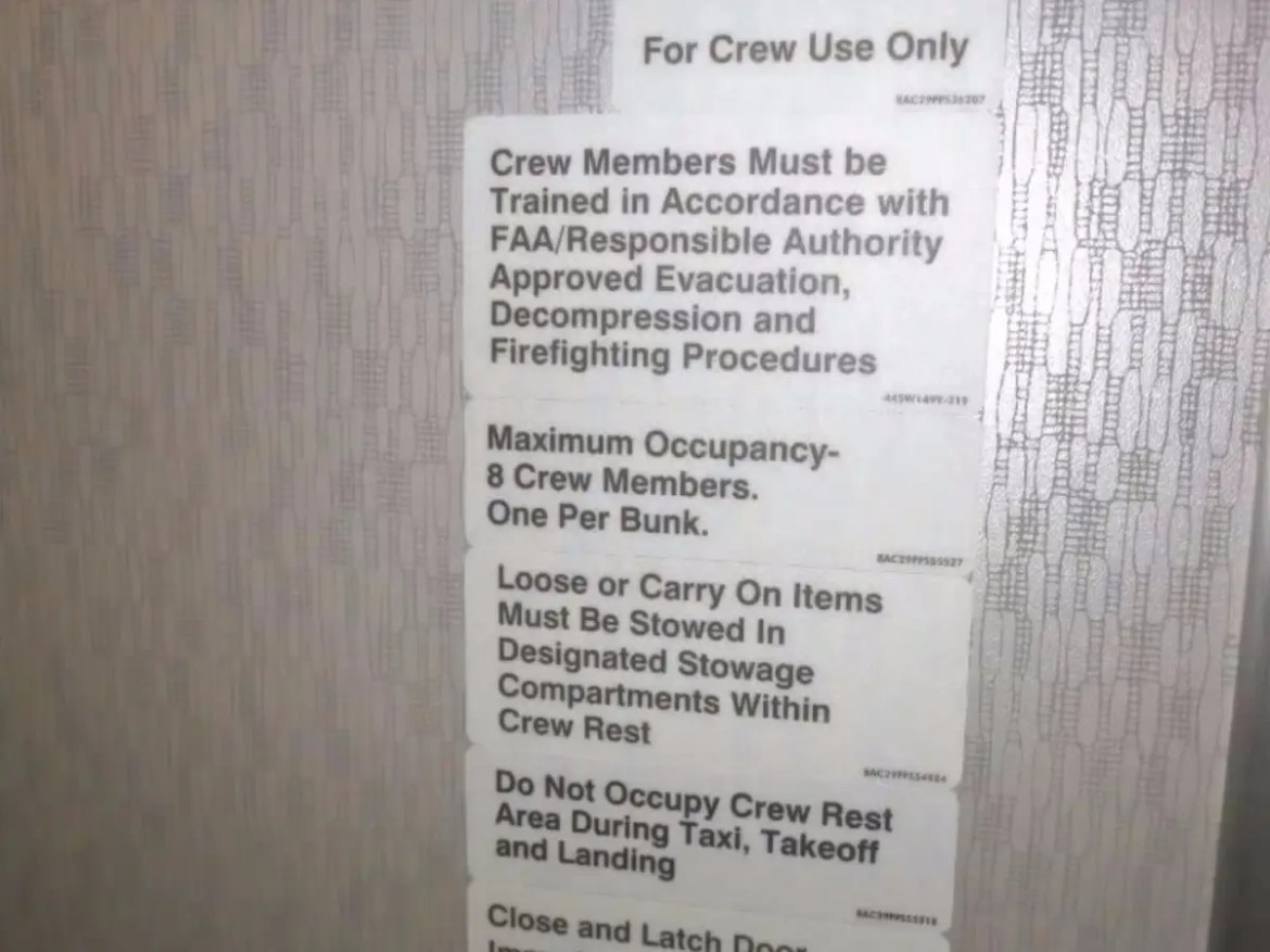 A sign divulges what's behind these doors (eight crew member bunks), though you've probably never read it that closely.