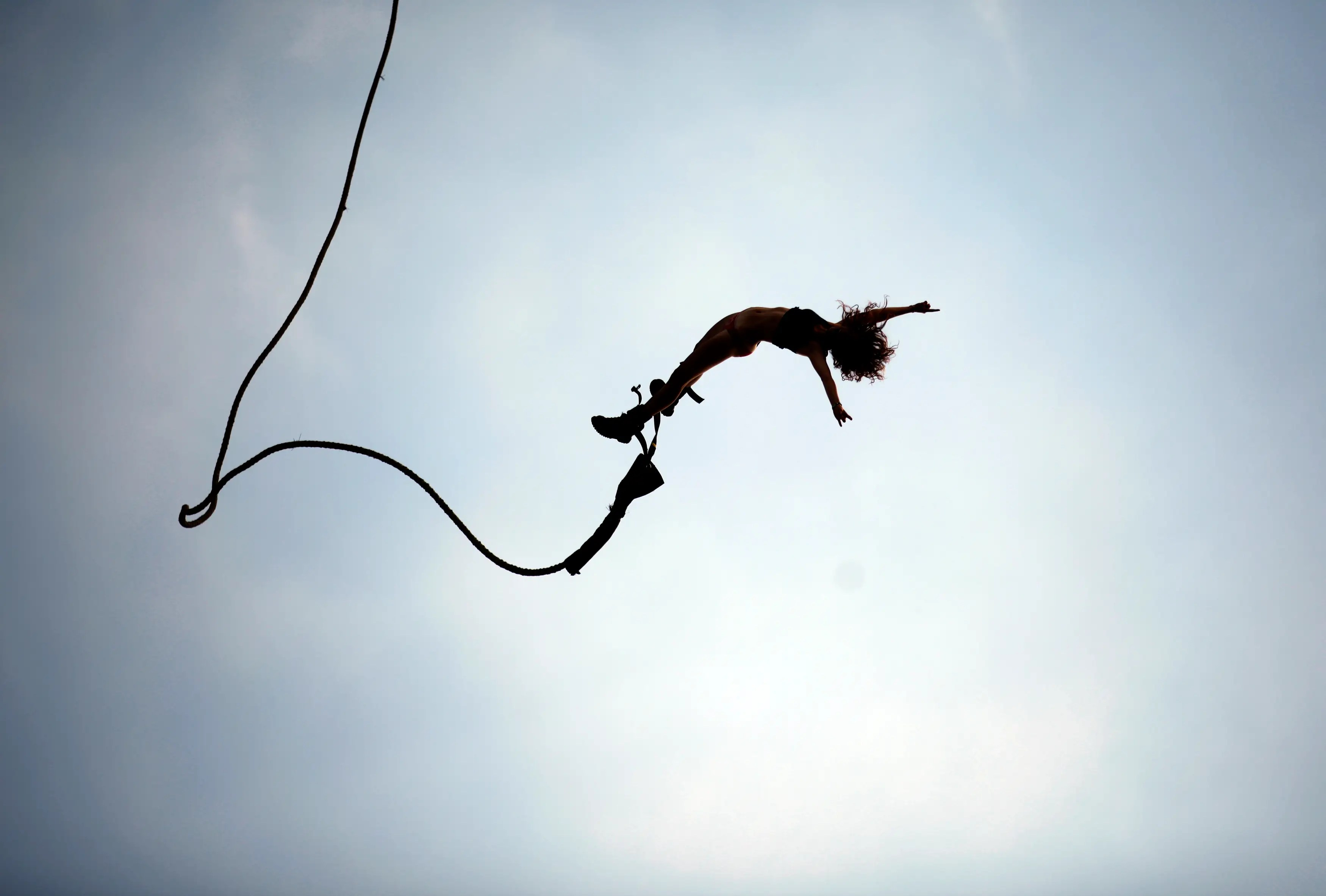 A reveller enjoys a bungee jump during the 17th Woodstock Festival in Kostrzyn-upon-Odra River, close to the Polish and German border.