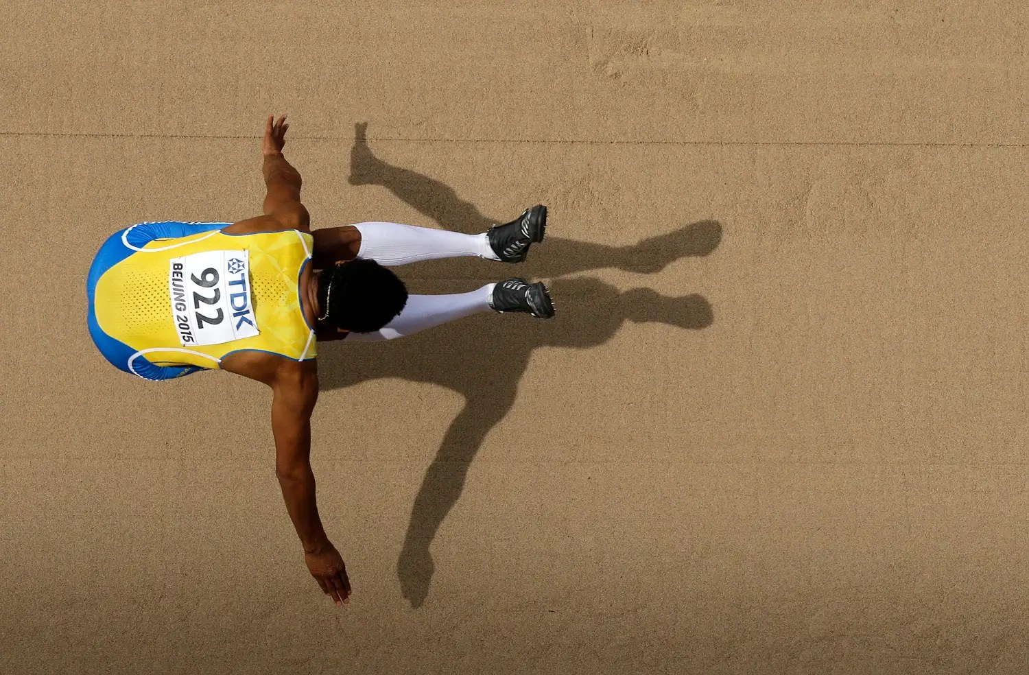 Swedish long jumper Michel Torneus leaps in his qualifying heat.