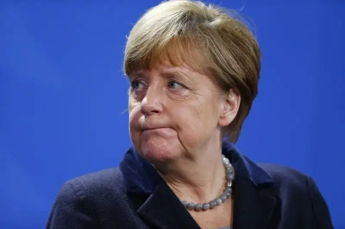 German Chancellor Angela Merkel addresses a news conference with Ukrainian President Petro Poroshenko at the Chancellery in Berlin, Germany, February 1, 2016. REUTERS/Hannibal Hanschke