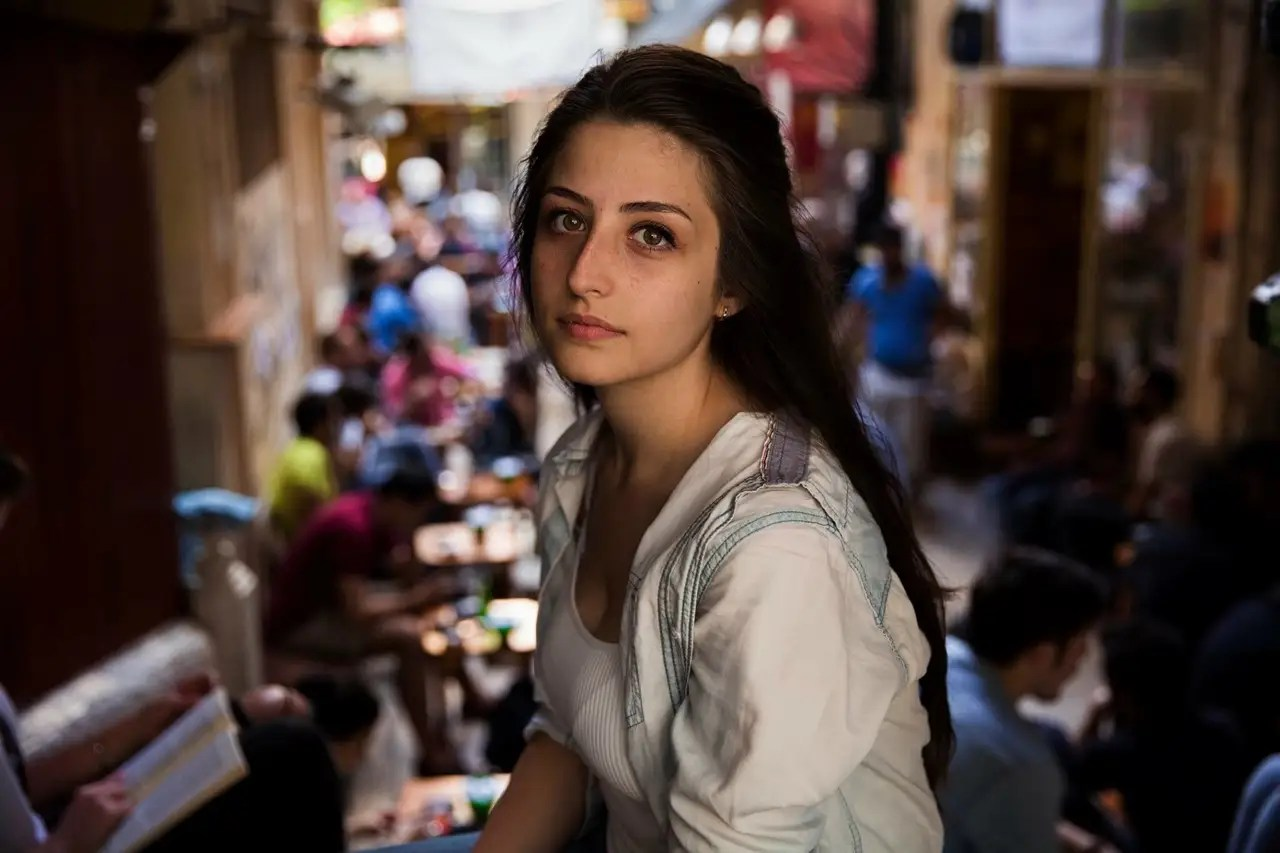 """""""Iprefer to photograph natural faces, without a lot of make-up,"""" Noroc says. Here, a woman sits at a tea house in Istanbul, Turkey."""