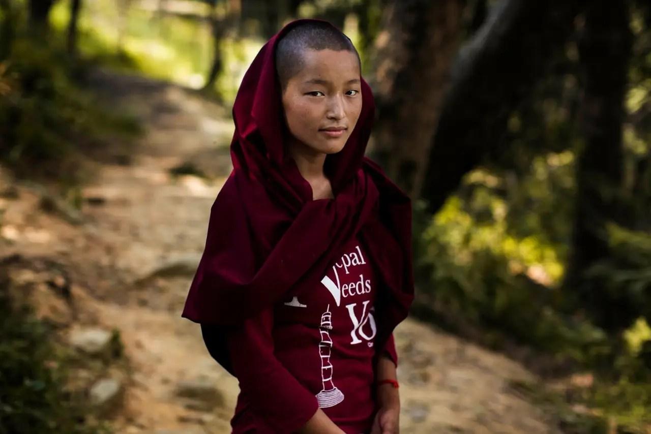 Here, a Buddhist nun poses in Kathmandu, Nepal.