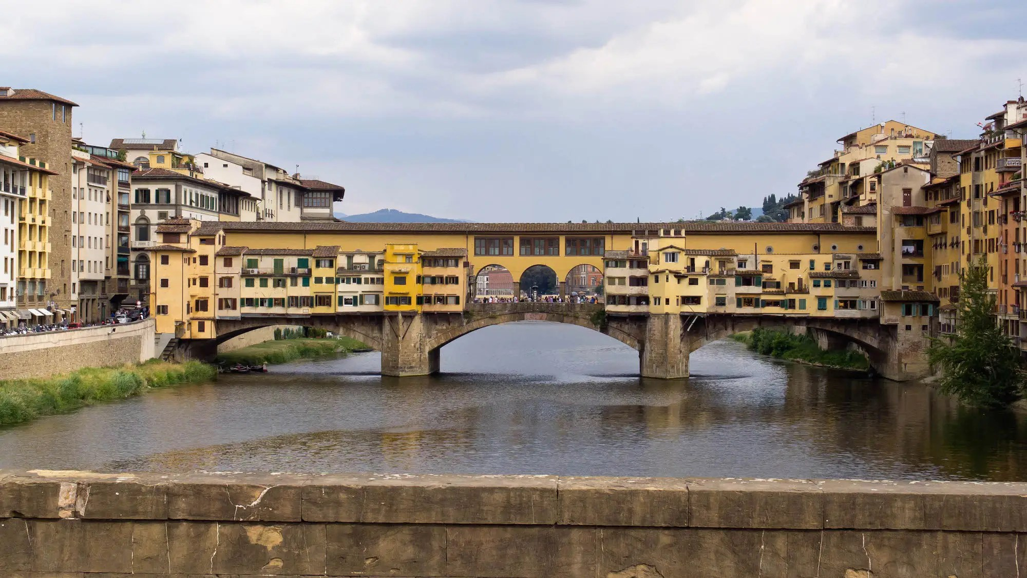 36. The shops nestled into the Ponte Vecchio arch bridge in Florence, Italy, were once home to butchers' shops, but are now occupied by souvenir-sellers.