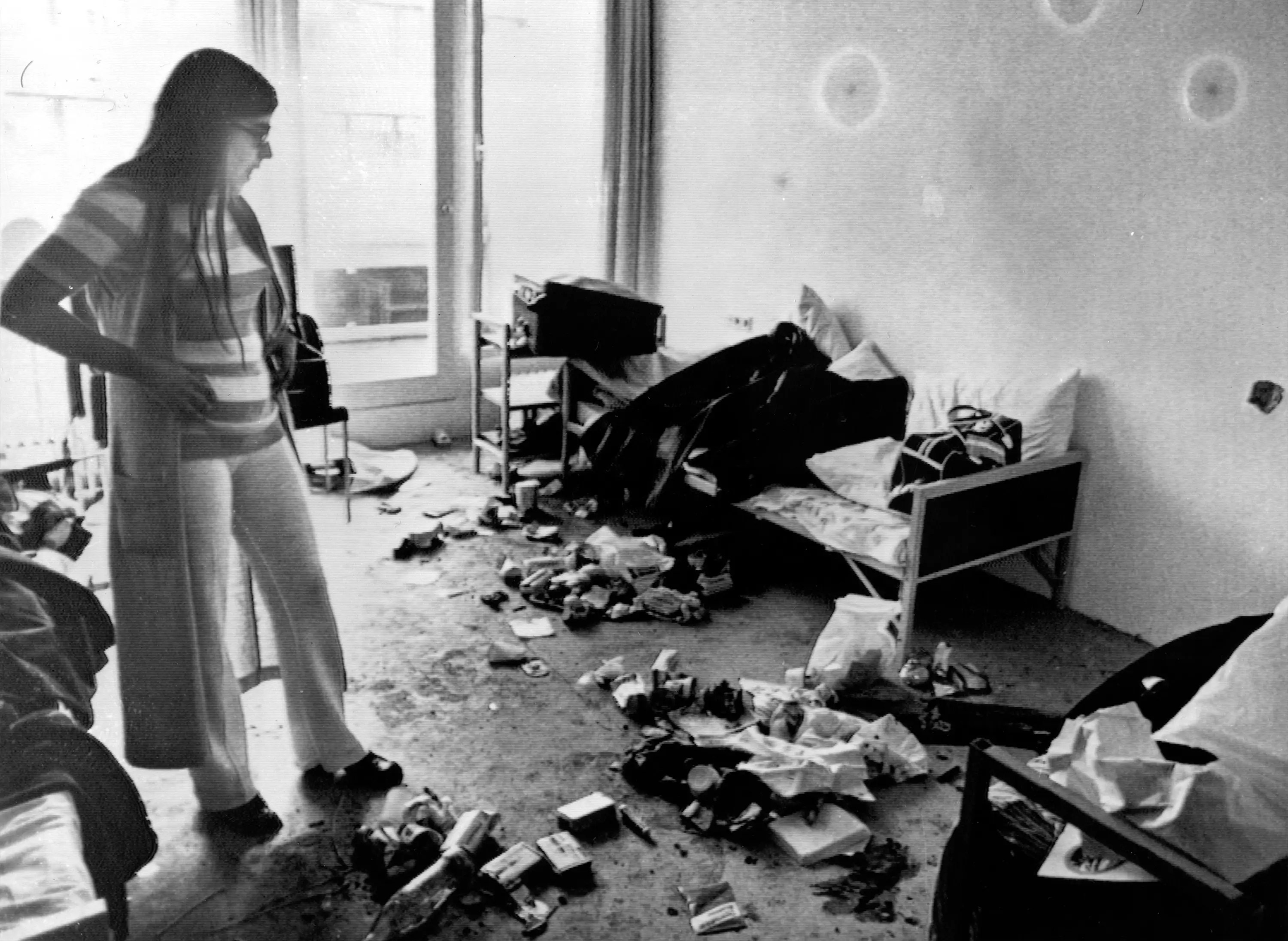 Munich, 1972: The games of 1972 had a dark shadow cast over them after 11 Israeli athletes were murdered in their accommodation by Palestinian terrorists. This photo shows Ankie Spitzer, widow of the Israeli fencing coach, Andre Spitzer, surveying the room where the incident occurred at Munich's Olympic Village. Chalk circles outline bullet holes in the wall.