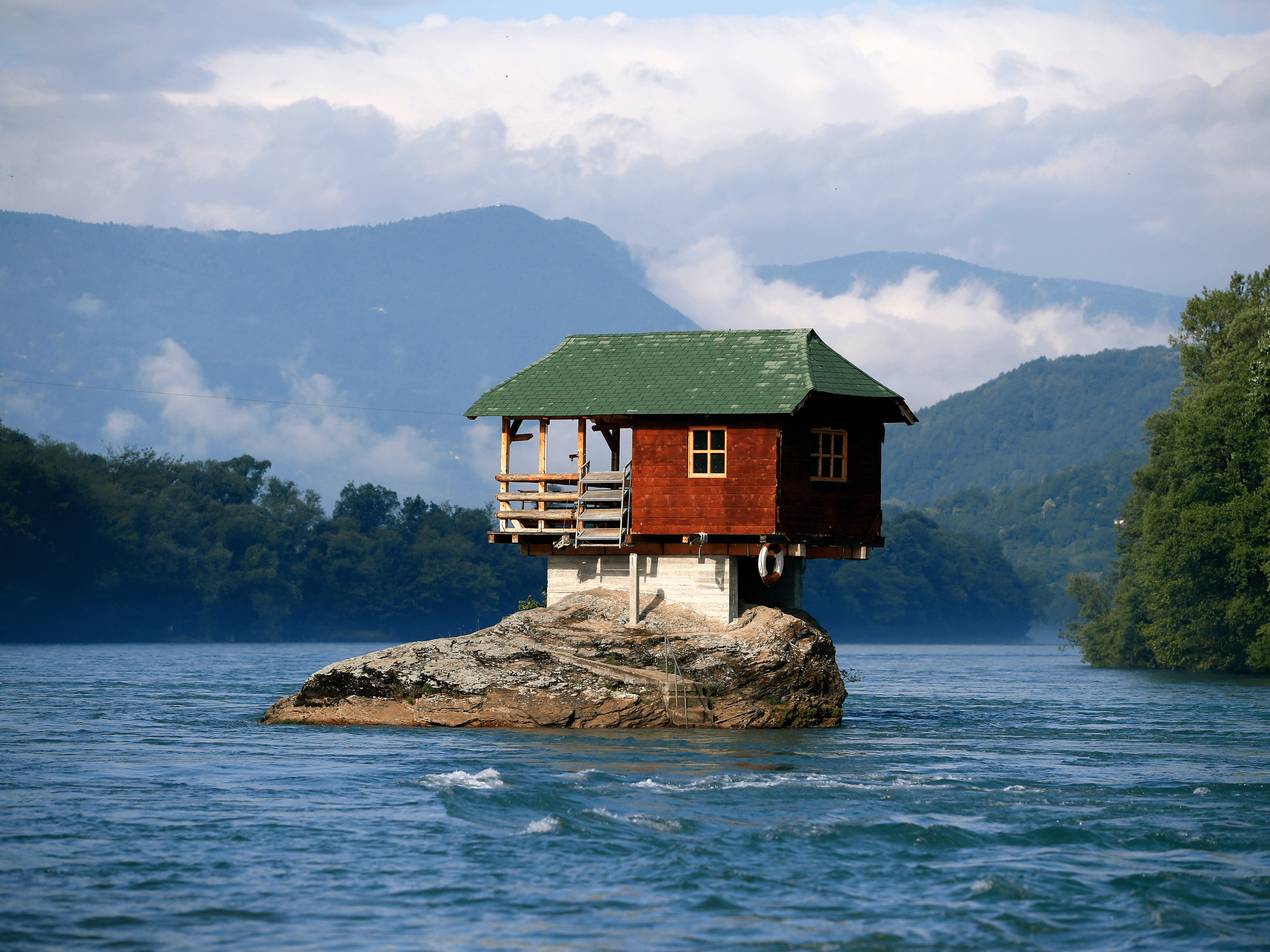 Near the Serbian town of Bajina Basta, a house built in 1968 has stood for nearly 50 years on top of a rock in the middle of the River Drina.