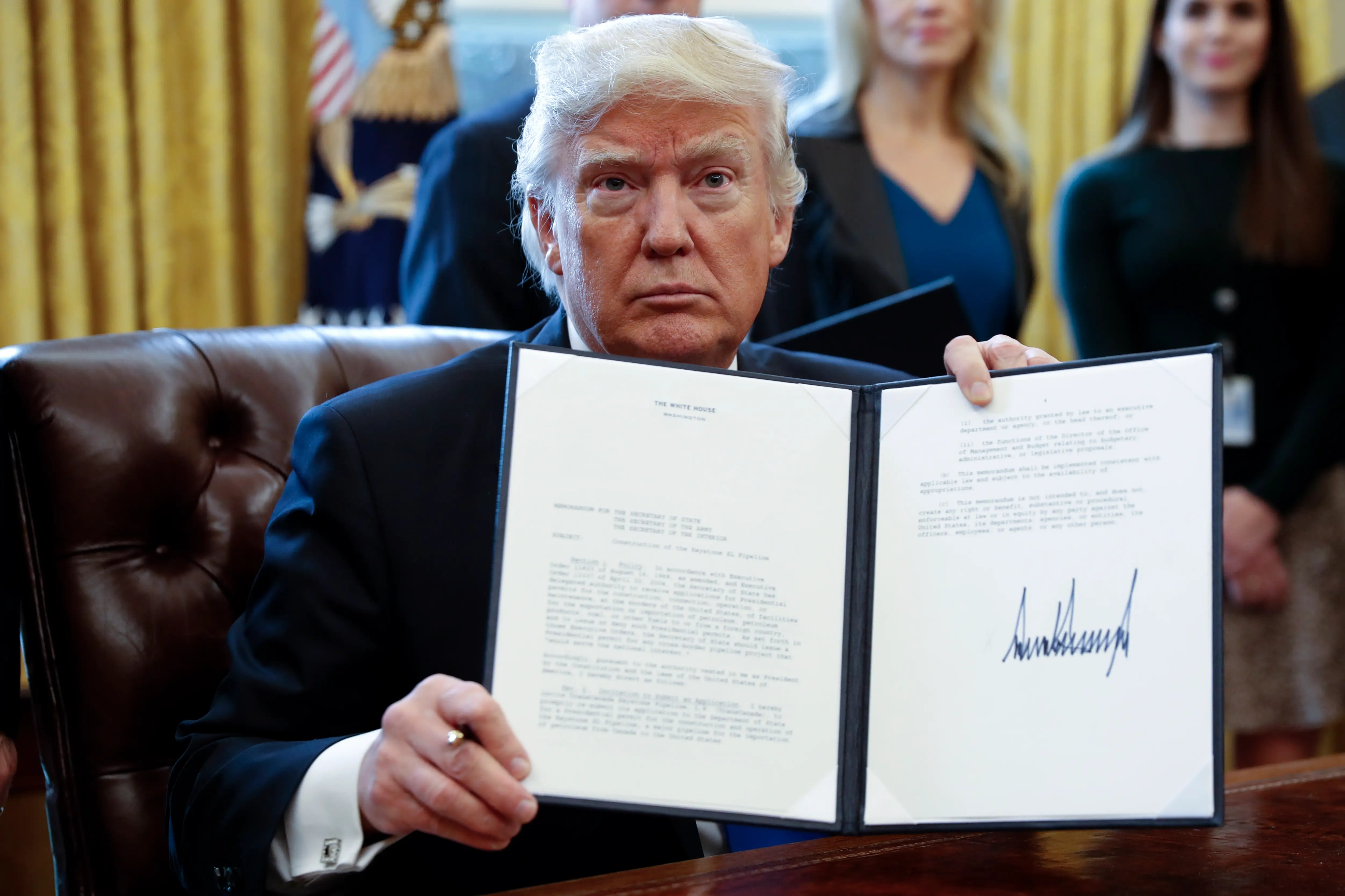 Image result for Trump Signs Executive Order Requiring That For Every One New Regulation, Two Must Be Revoked